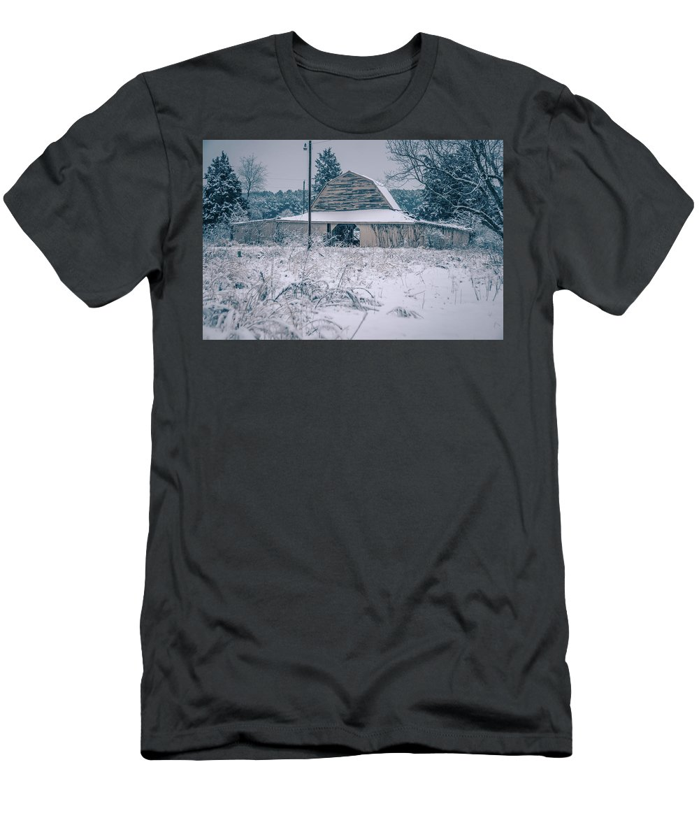 Field Men's T-Shirt (Athletic Fit) featuring the photograph Fresh Snow Sits On The Ground Around An Old Barn by Alex Grichenko