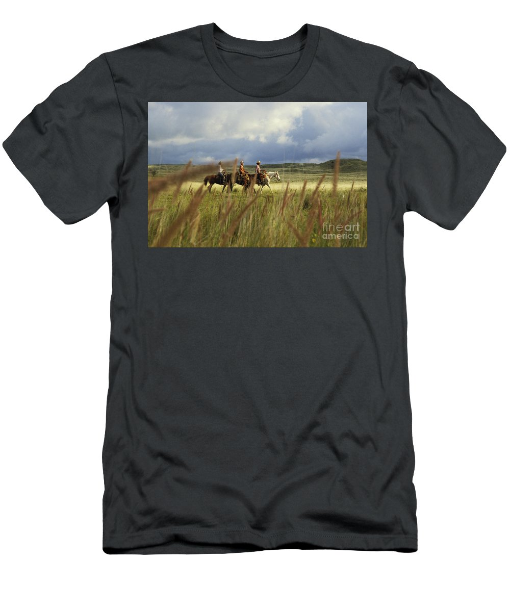 Afternoon Men's T-Shirt (Athletic Fit) featuring the photograph Hawaiian Cowboys by David Cornwell - Printscapes