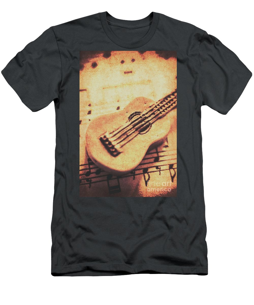 Folk Men's T-Shirt (Athletic Fit) featuring the photograph Little Carved Guitar On Sheet Music by Jorgo Photography - Wall Art Gallery
