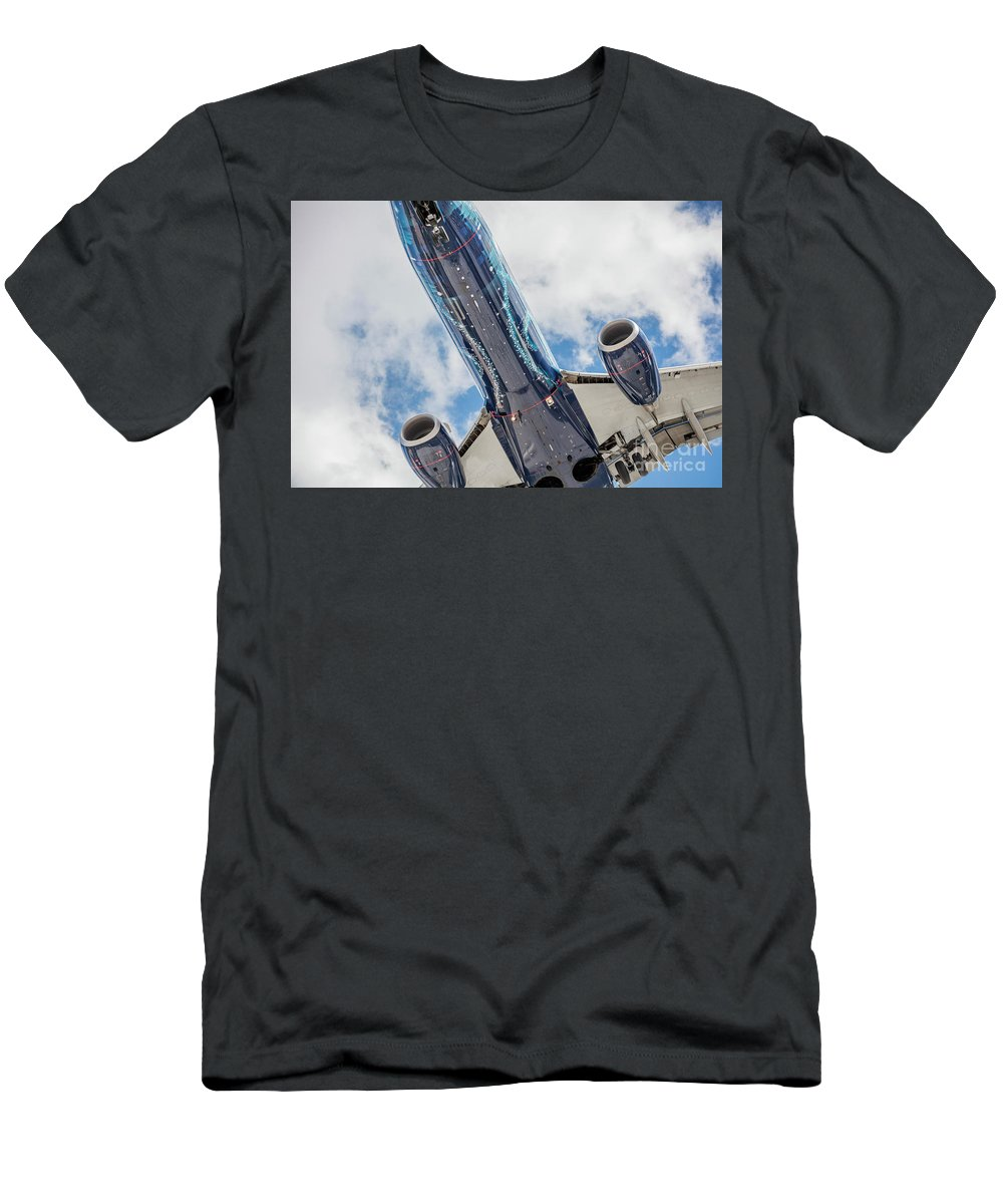 Commercial Men's T-Shirt (Athletic Fit) featuring the photograph Passenger Jet Coming In For Landing 3 by PhotoStock-Israel