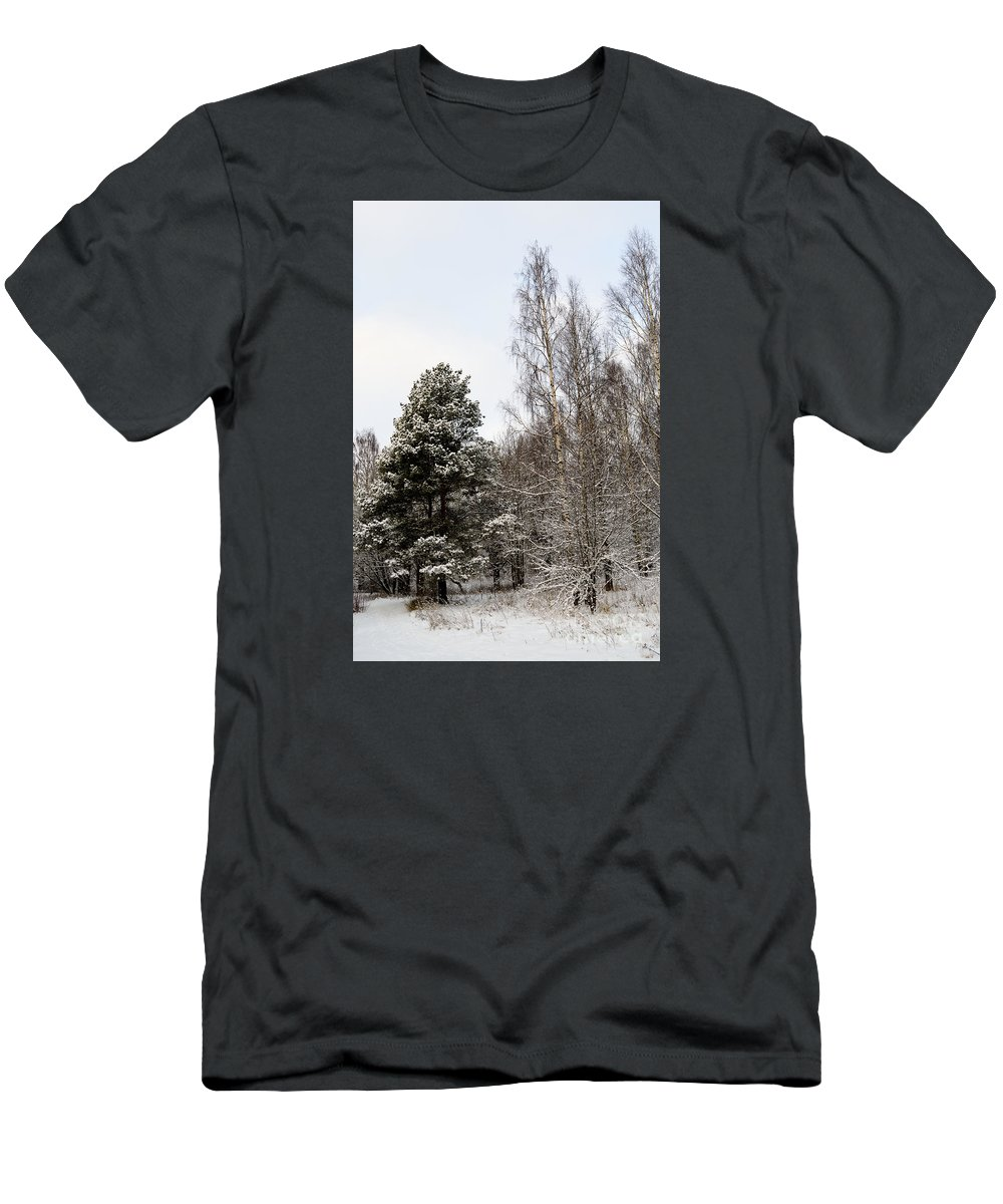 Snow Men's T-Shirt (Athletic Fit) featuring the photograph Snowy Forest Edge by Esko Lindell