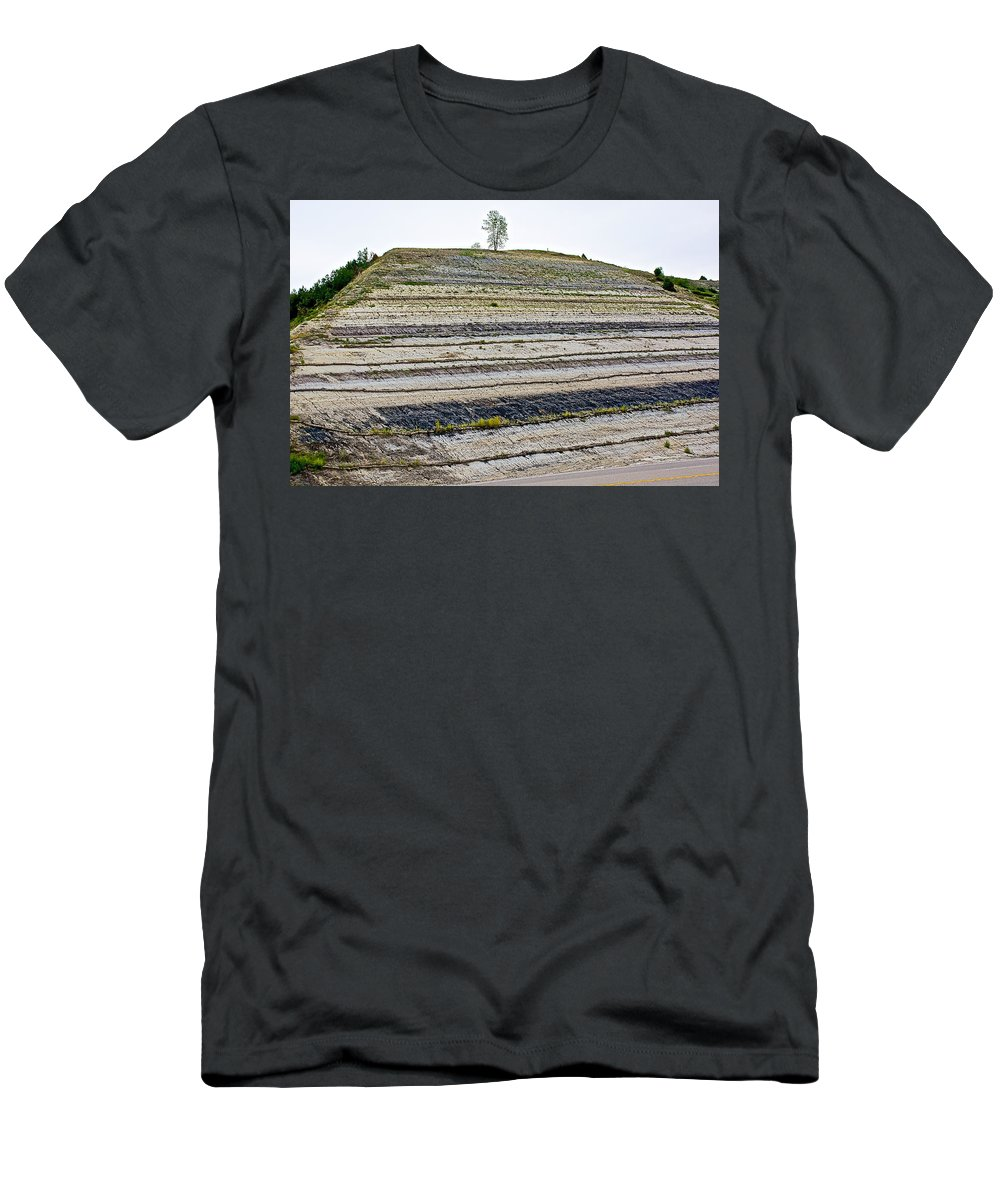 Striped Bank On Side Of A Road In Northwest North Dakota Men's T-Shirt (Athletic Fit) featuring the photograph Striped Bank On Side Of A Road In Northwest North Dakota by Ruth Hager