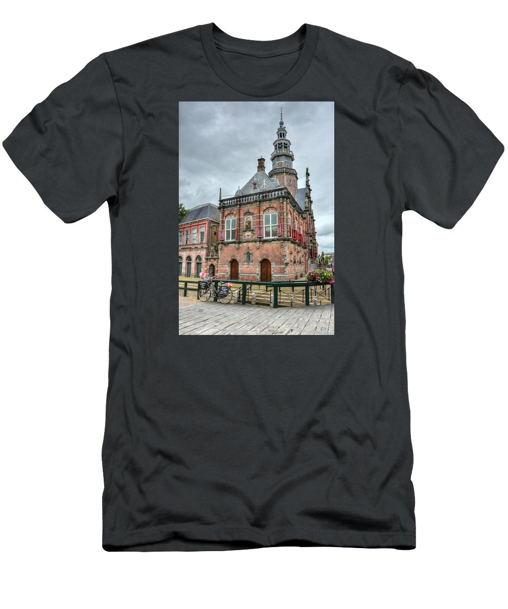 Bolsward Men's T-Shirt (Athletic Fit) featuring the photograph Town Hall by Joan Baker