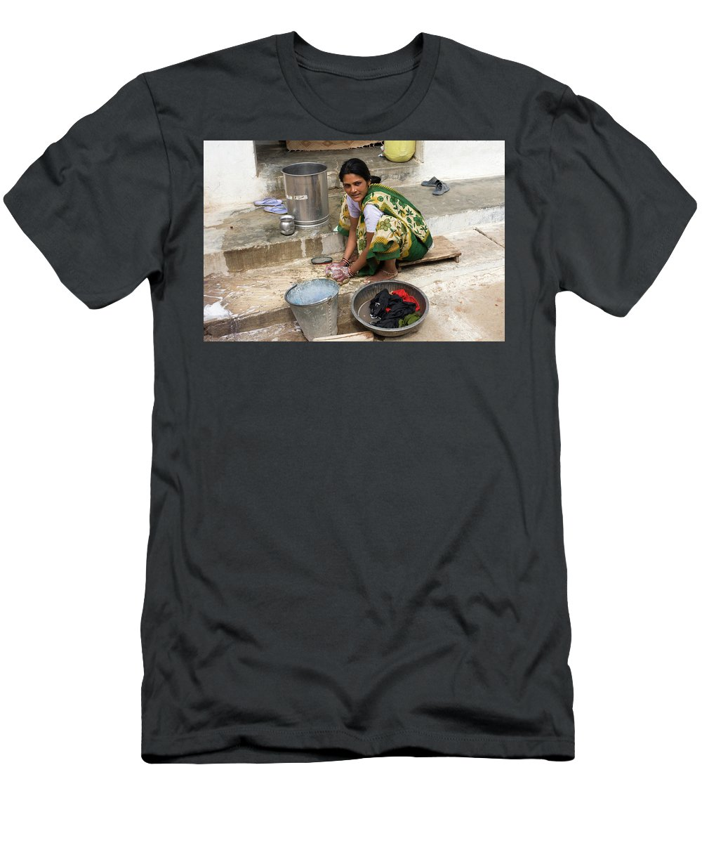 Khajuraho Village Men's T-Shirt (Athletic Fit) featuring the photograph Woman Washing Clothes In Khajuraho Village by Aivar Mikko