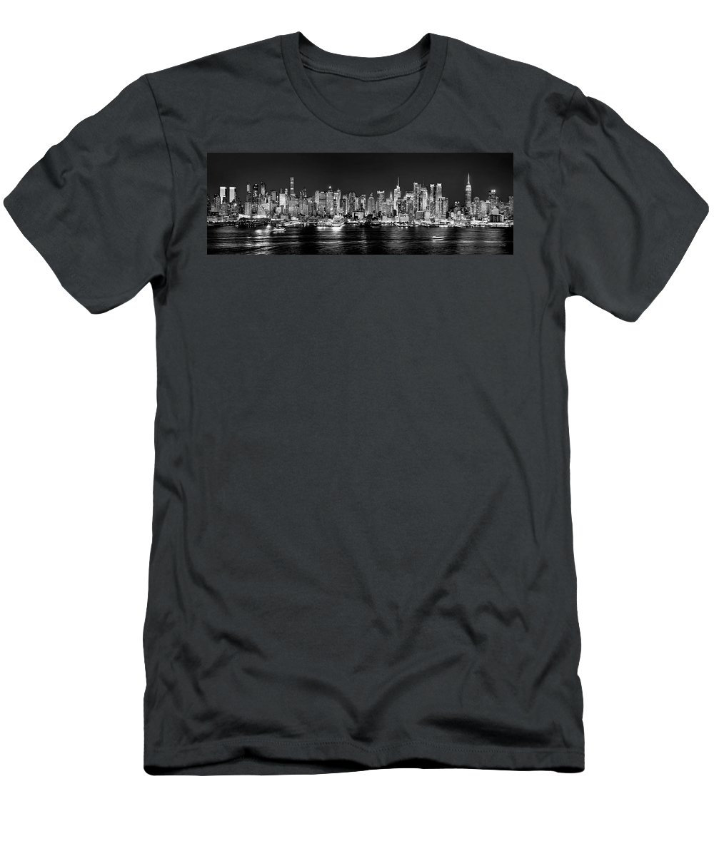 New York City Skyline At Night Men's T-Shirt (Athletic Fit) featuring the photograph New York City Nyc Skyline Midtown Manhattan At Night Black And White by Jon Holiday