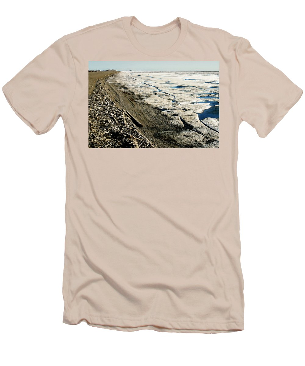 Drift Wood Men's T-Shirt (Athletic Fit) featuring the photograph Driftwood On The Frozen Arctic Coast by Anthony Jones