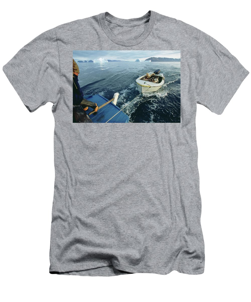 Adventure Men's T-Shirt (Athletic Fit) featuring the photograph An Inuit Hunter Ferries His Sled Dogs by David McLain