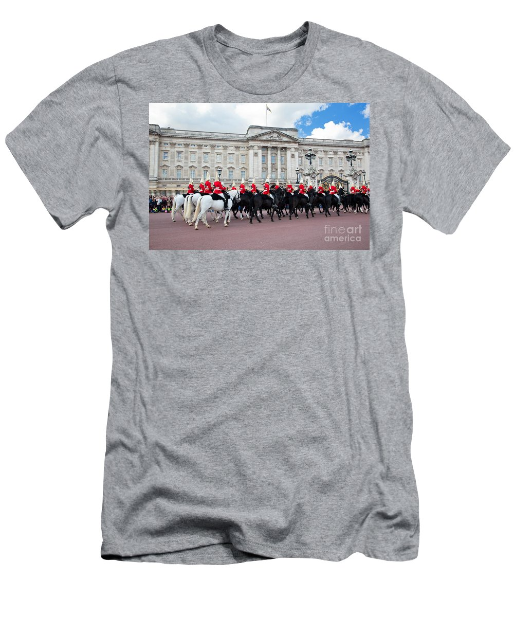 London Men's T-Shirt (Athletic Fit) featuring the photograph British Royal Guards Perform The Changing Of The Guard In Buckingham Palace by Michal Bednarek