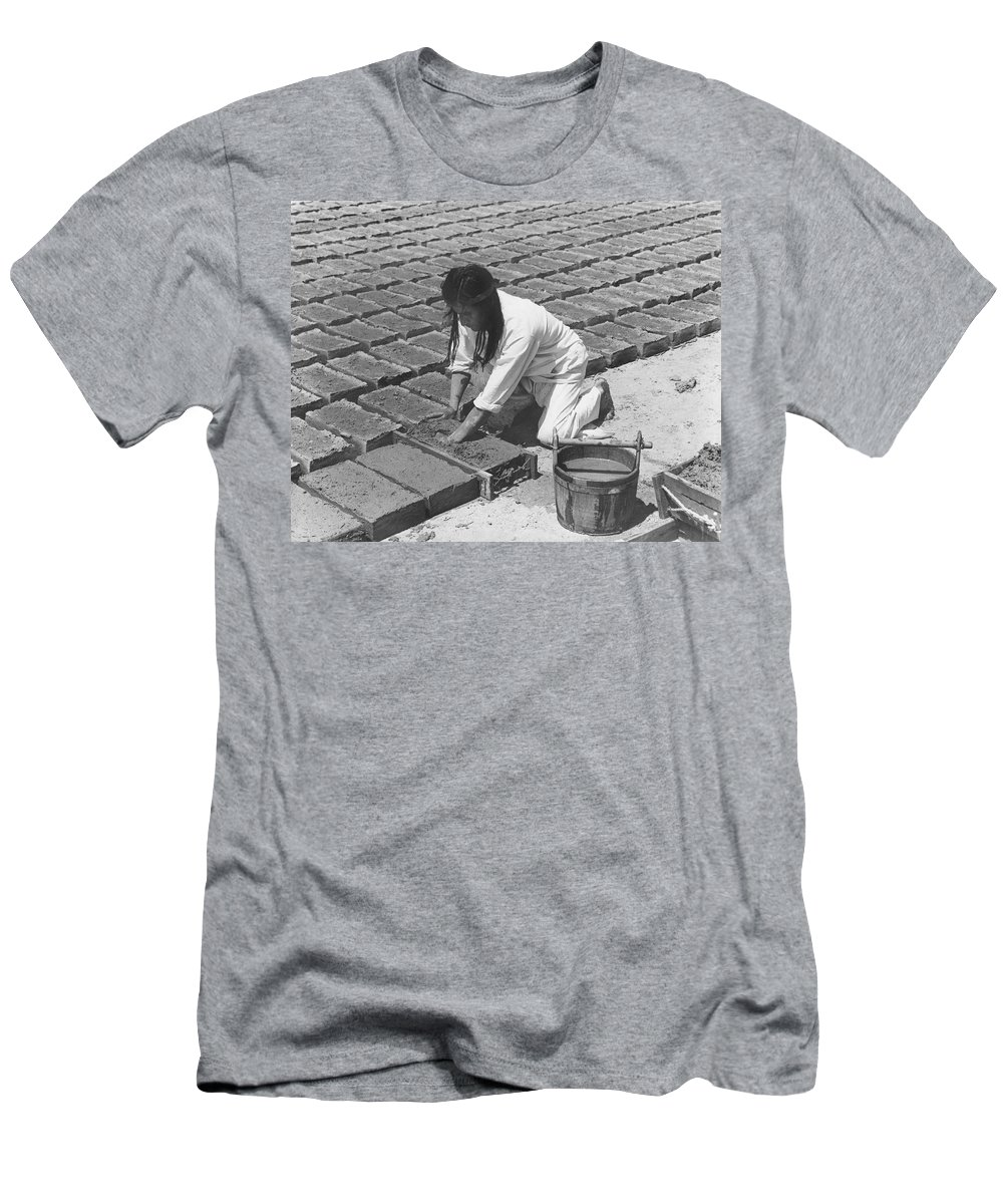 1 Person Only Men's T-Shirt (Athletic Fit) featuring the photograph Indians Making Adobe Bricks by Underwood Archives Onia