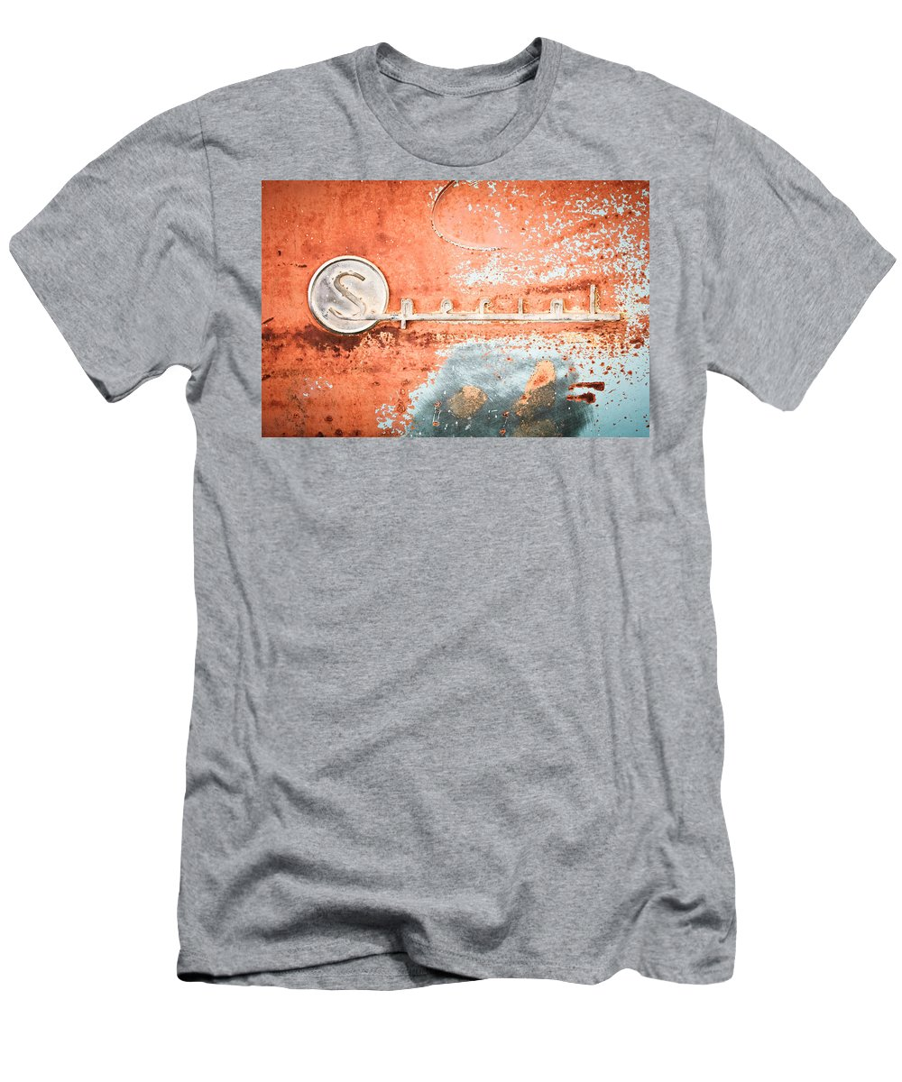 1954 Buick Special Men's T-Shirt (Athletic Fit) featuring the photograph 1954 Buick Special Emblem by Jill Reger
