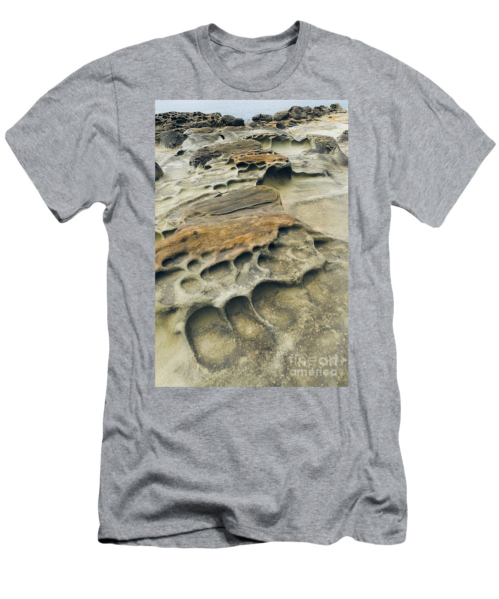 Nature Men's T-Shirt (Athletic Fit) featuring the photograph Eroded Sandstone Cliff Along The Ocean by John Shaw