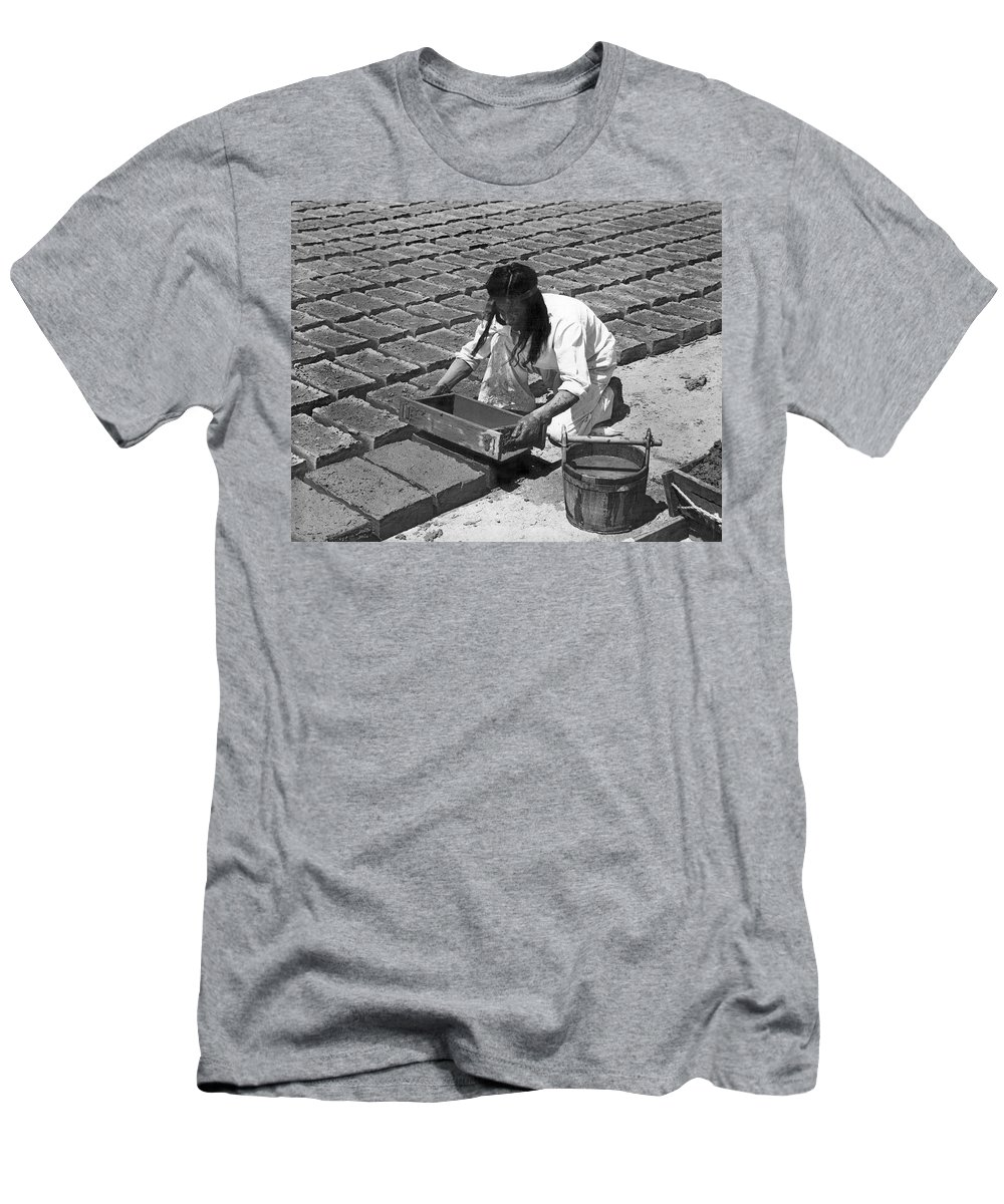 1 Person Men's T-Shirt (Athletic Fit) featuring the photograph Indians Making Adobe Bricks by Underwood Archives