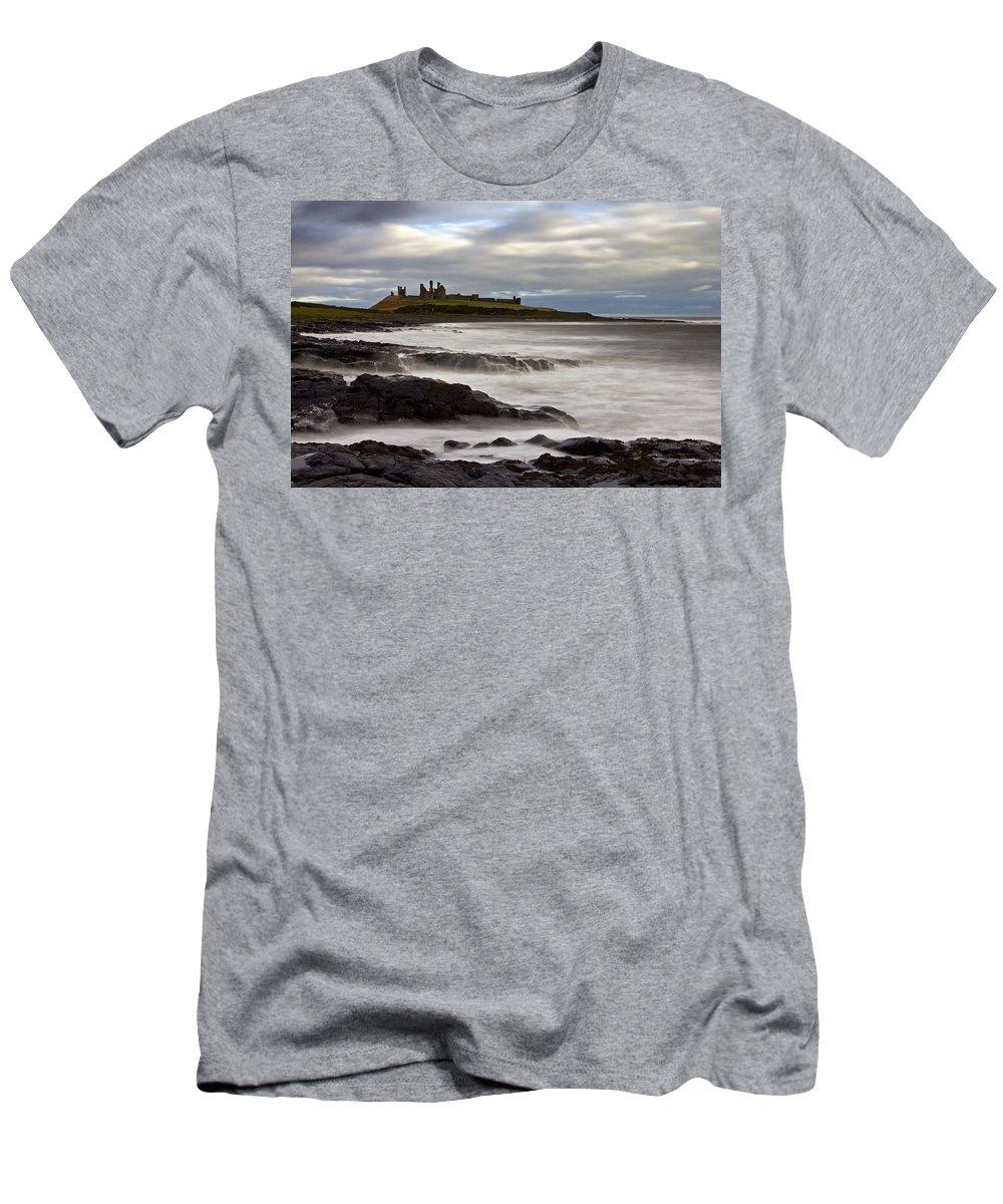 Dunstanburgh Castle Men's T-Shirt (Athletic Fit) featuring the photograph Dunstanburgh Castle by David Pringle