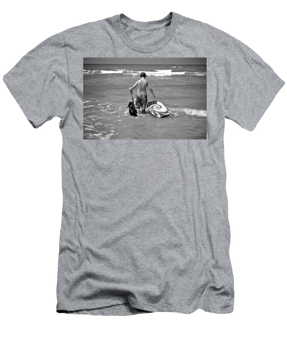 Surf Men's T-Shirt (Athletic Fit) featuring the photograph A Boy And His Dog Go Surfing by Kristina Deane
