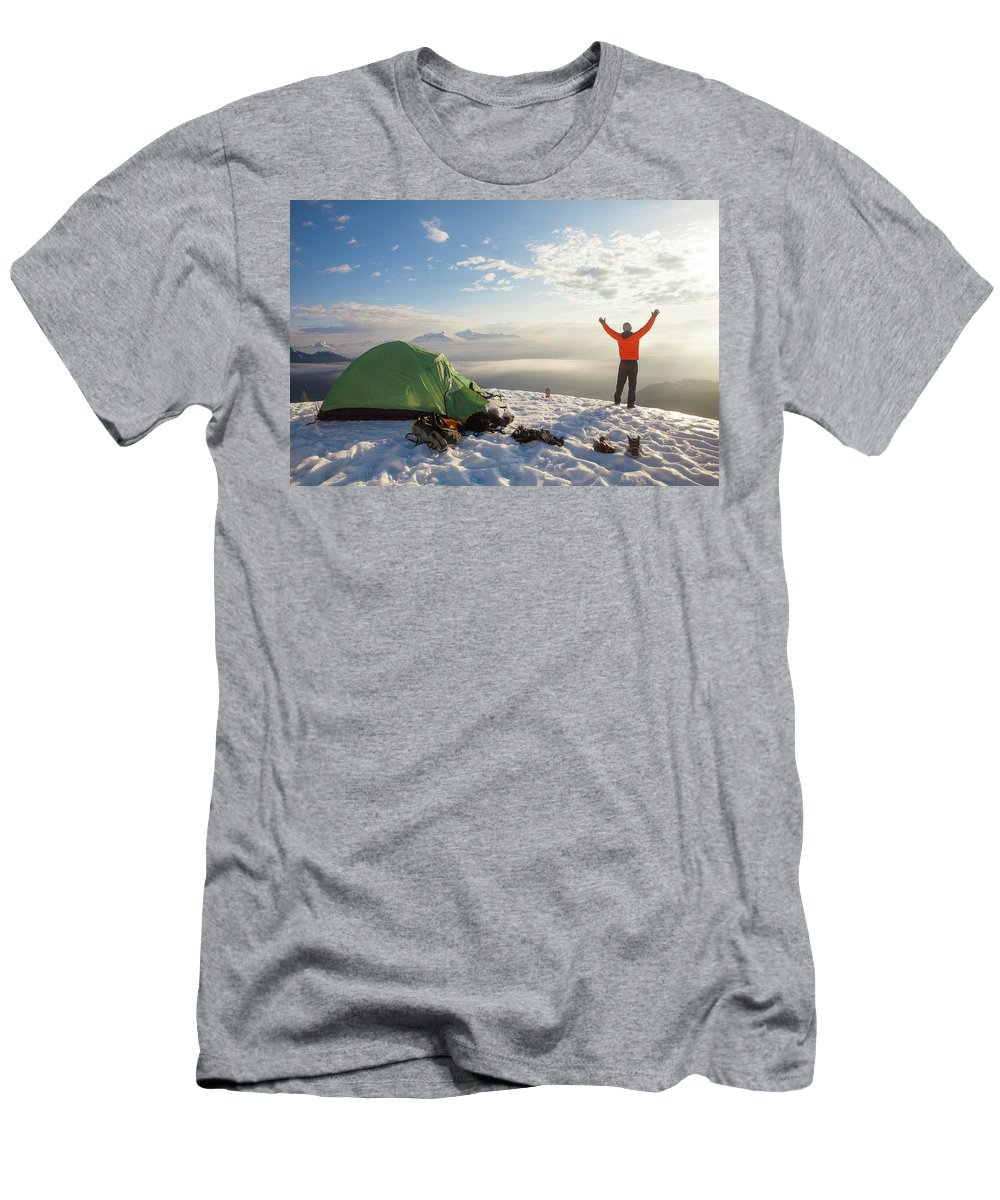 25-29 Years Men's T-Shirt (Athletic Fit) featuring the photograph A Camper Lifts His Hand In The Air by Christopher Kimmel