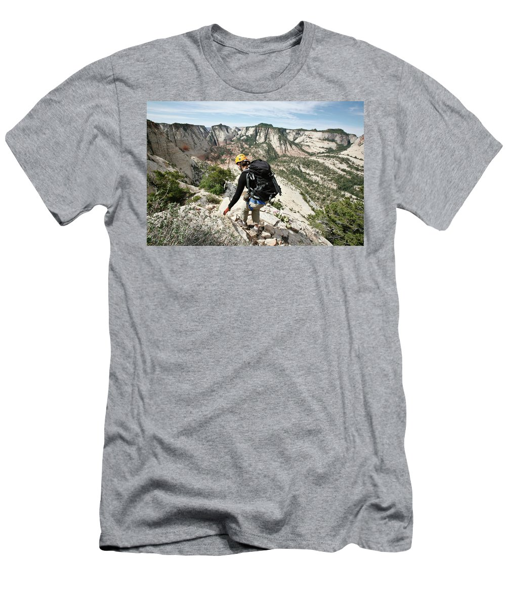 25-29 Years Men's T-Shirt (Athletic Fit) featuring the photograph A Woman Cautiously Navigates A Steep by Christopher Beauchamp