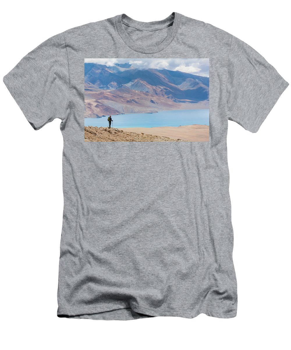 Beauty In Nature Men's T-Shirt (Athletic Fit) featuring the photograph A Woman Is Hiking Toward Tsomoriri by Andrew Peacock