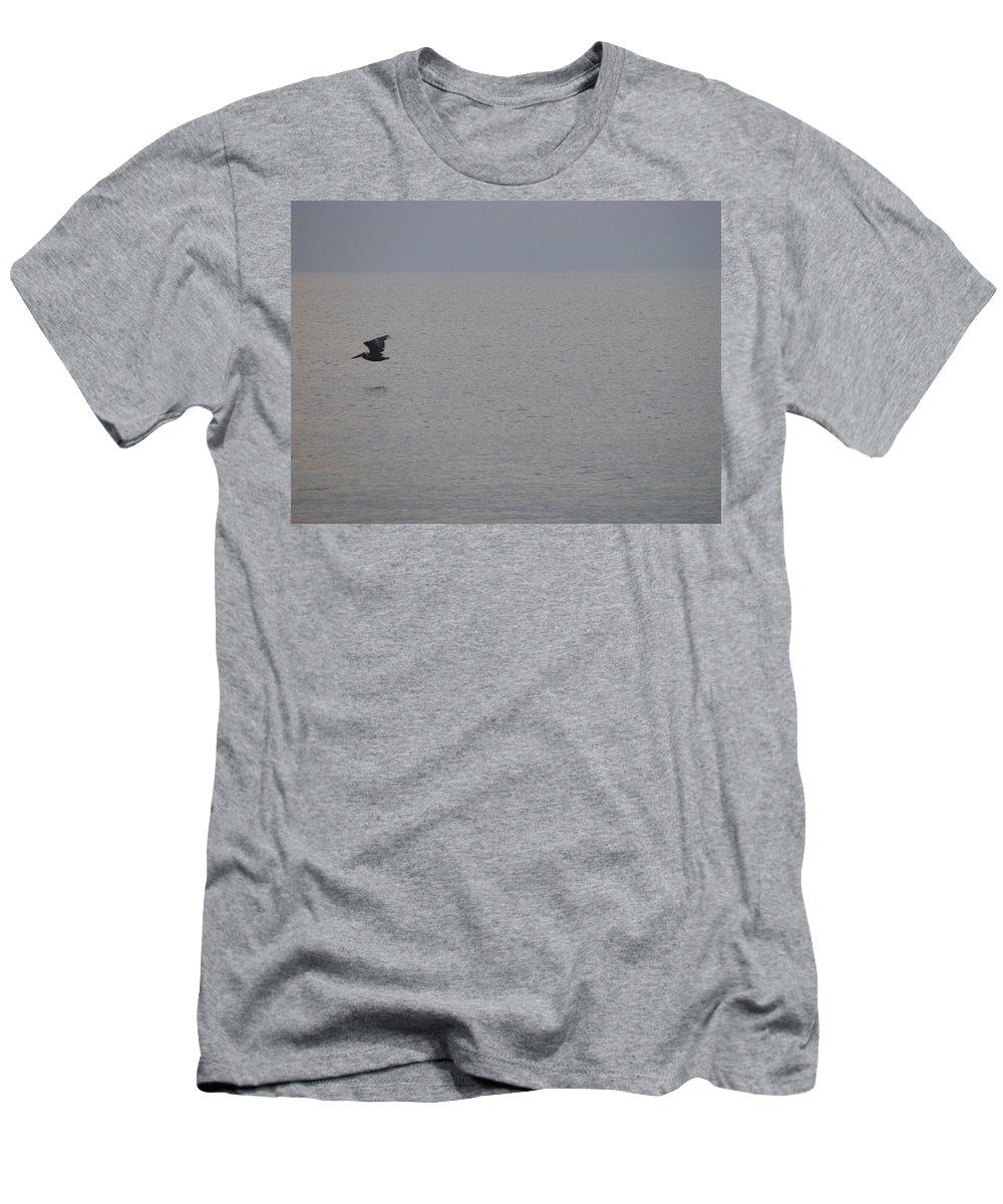 Landscape Men's T-Shirt (Athletic Fit) featuring the photograph Brown Pelican In Flight by Ellen Meakin