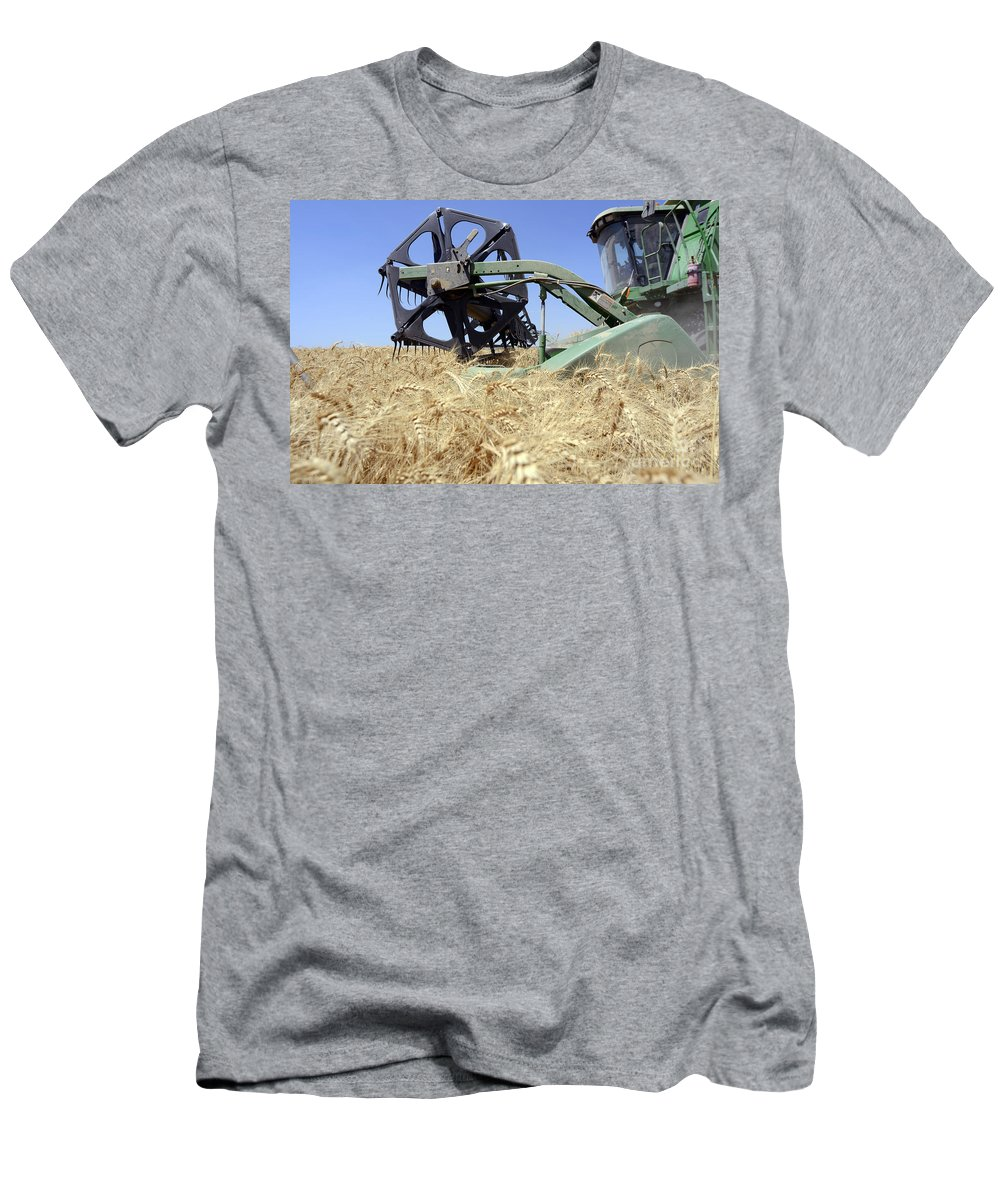 Combine Harvester Men's T-Shirt (Athletic Fit) featuring the photograph Combine Harvester by Shay Fogelman