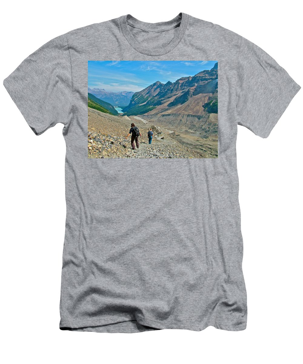 Couple Hiking On Plain Of Six Glaciers In Banff National Park Men's T-Shirt (Athletic Fit) featuring the photograph Couple Hiking On Plain Of Six Glaciers Trail In Banff Np-albert by Ruth Hager