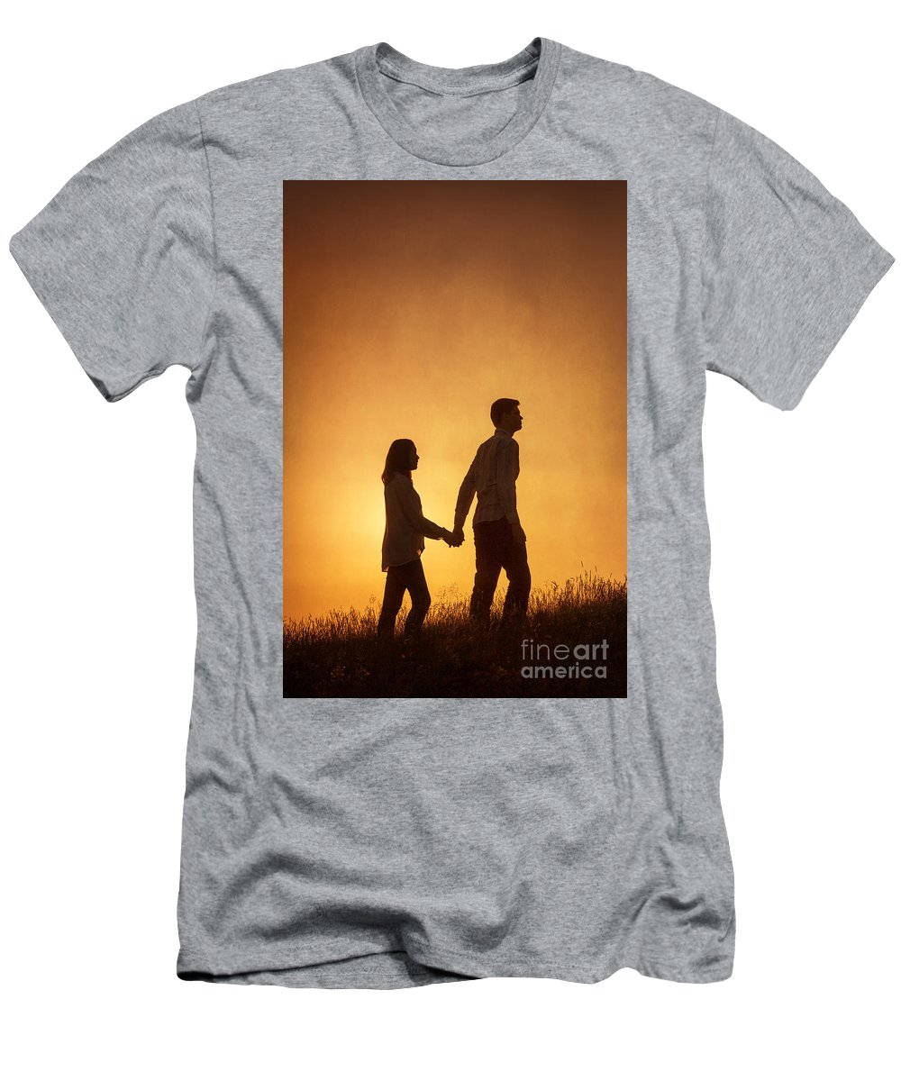 Couple Men's T-Shirt (Athletic Fit) featuring the photograph Couple Holding Hands At Sunset by Lee Avison