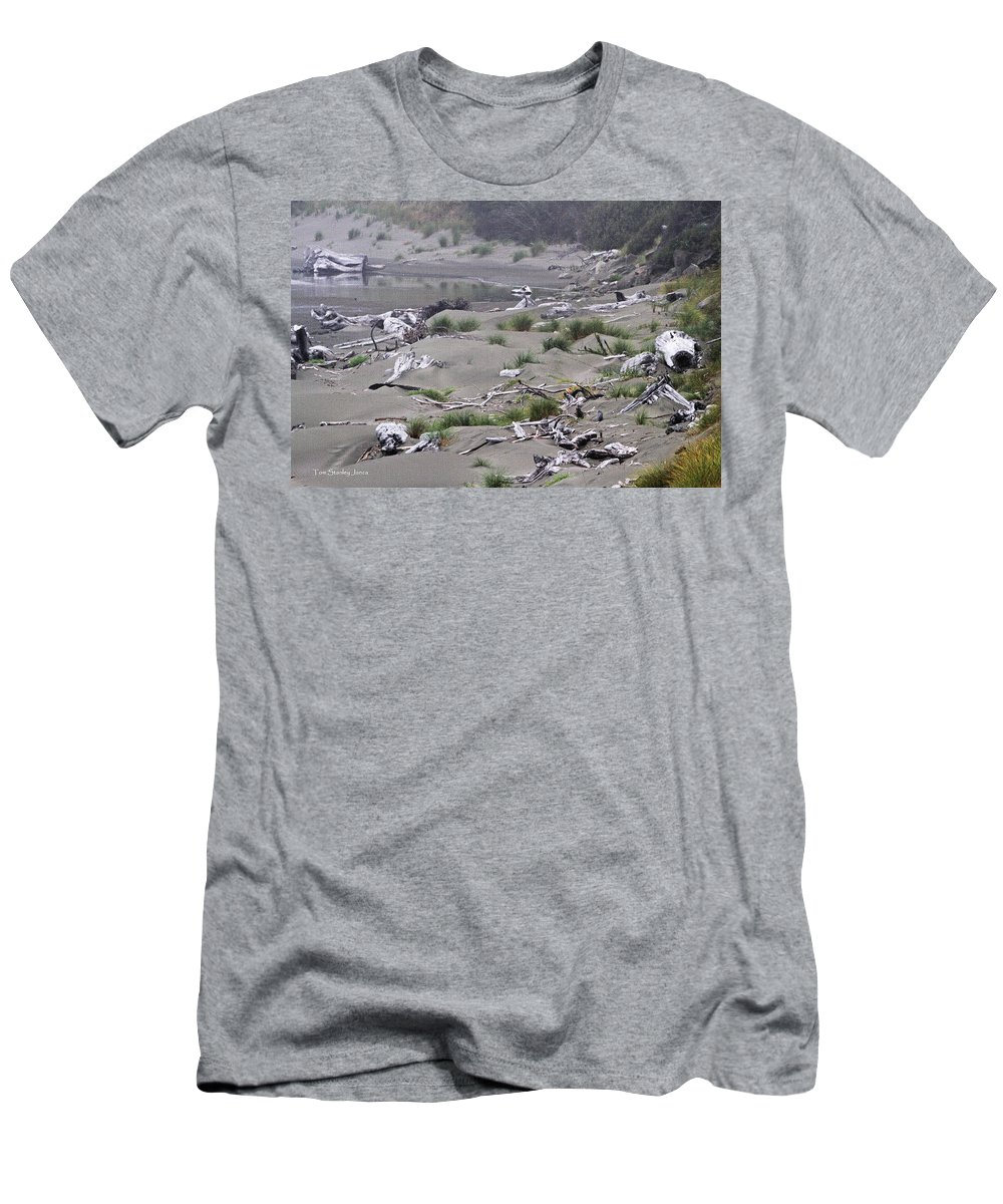 Driftwood On The Beach Men's T-Shirt (Athletic Fit) featuring the photograph Driftwood On The Beach by Tom Janca