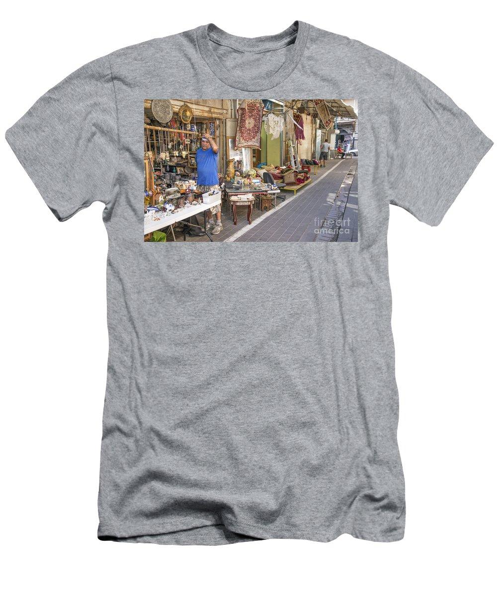 Aviv Men's T-Shirt (Athletic Fit) featuring the photograph Flea Market Shop In Tel Aviv Israel by Jacek Malipan