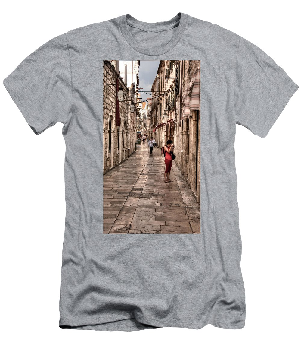 Girl In Red Men's T-Shirt (Athletic Fit) featuring the photograph Girl In Red In The White Streets Of Dubrovnik by Weston Westmoreland