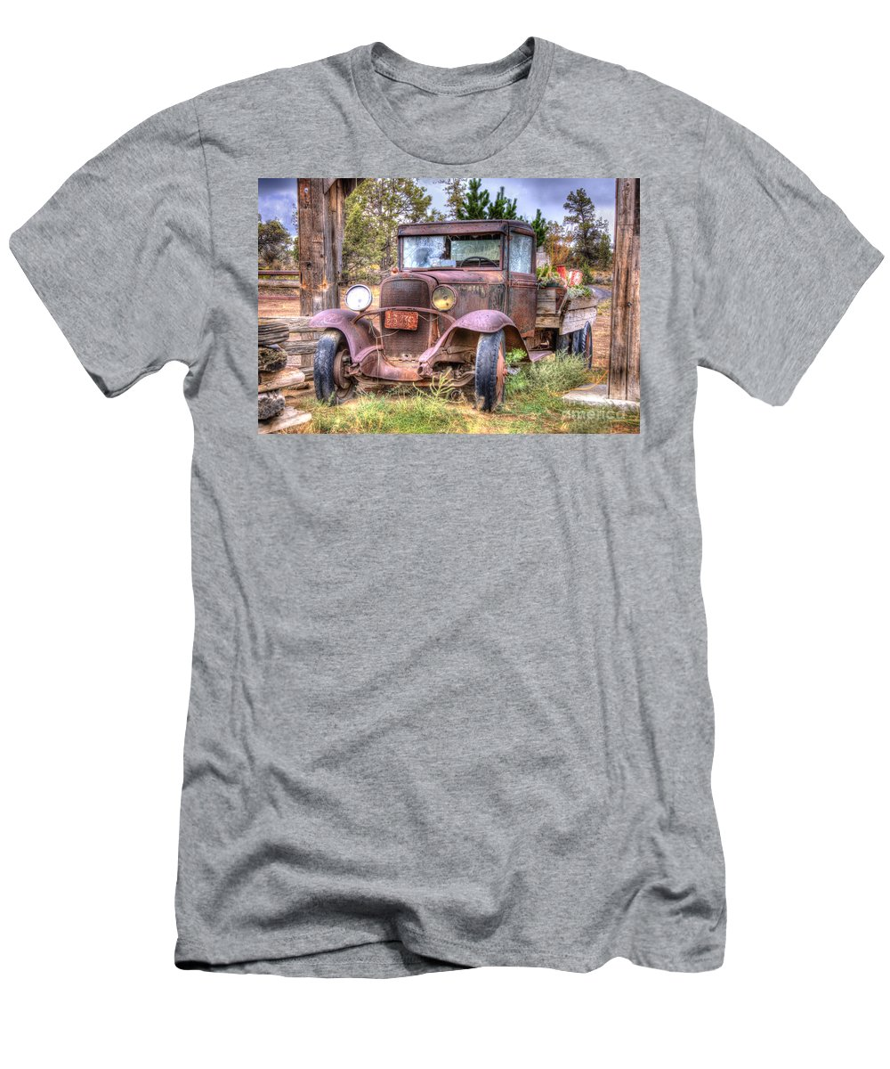 Abandoned Men's T-Shirt (Athletic Fit) featuring the photograph Junk Yard Special by Juli Scalzi