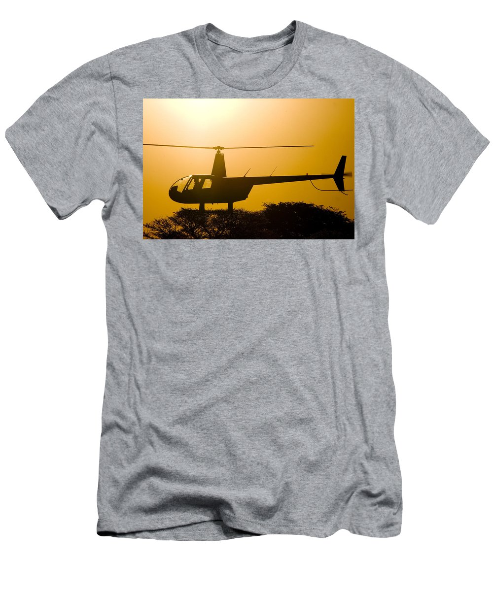 Robinson R44 Raven Ii Men's T-Shirt (Athletic Fit) featuring the photograph Landing On A Tree by Paul Job