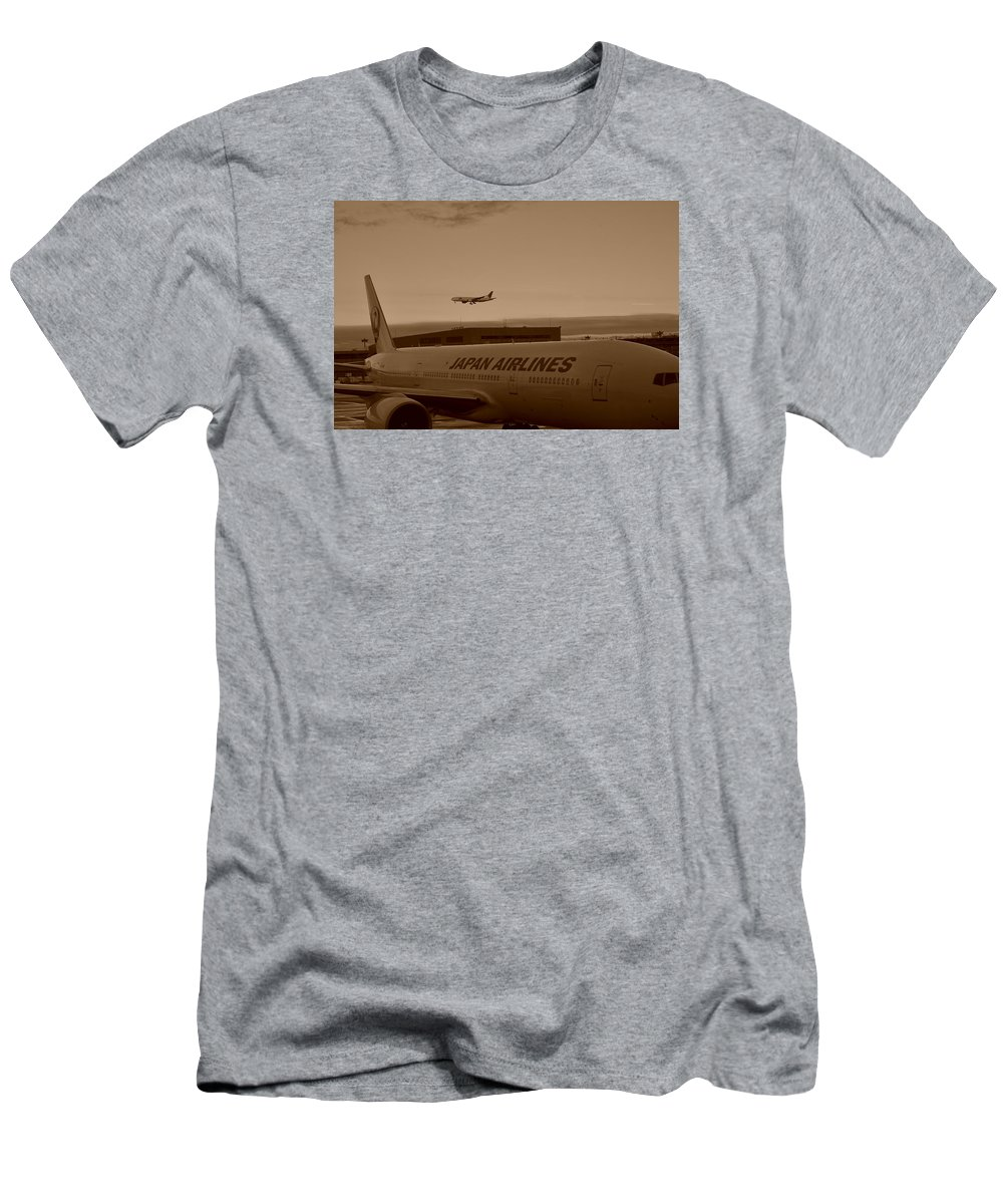 Departure Men's T-Shirt (Athletic Fit) featuring the photograph Leaving Japan by Miguel Winterpacht