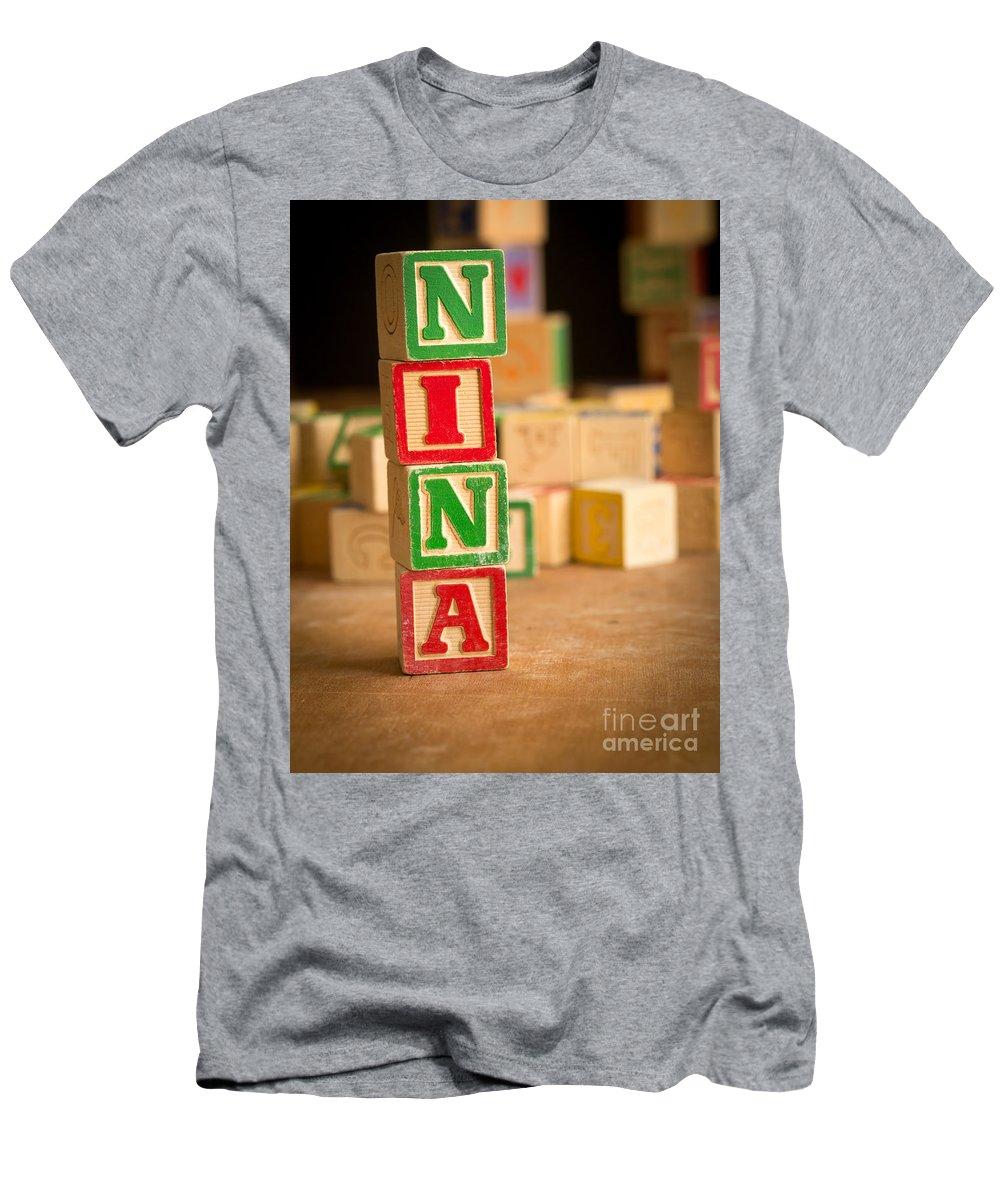 Abcs Men's T-Shirt (Athletic Fit) featuring the photograph Nina - Alphabet Blocks by Edward Fielding