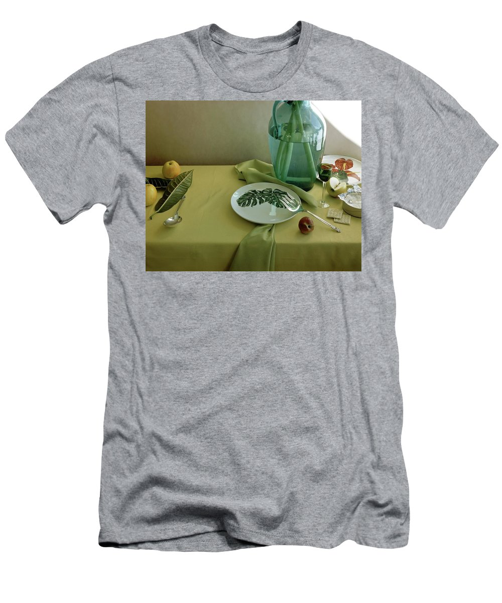 Table Setting Men's T-Shirt (Athletic Fit) featuring the photograph Plates, Apples And A Vase On A Green Tablecloth by Horst P. Horst