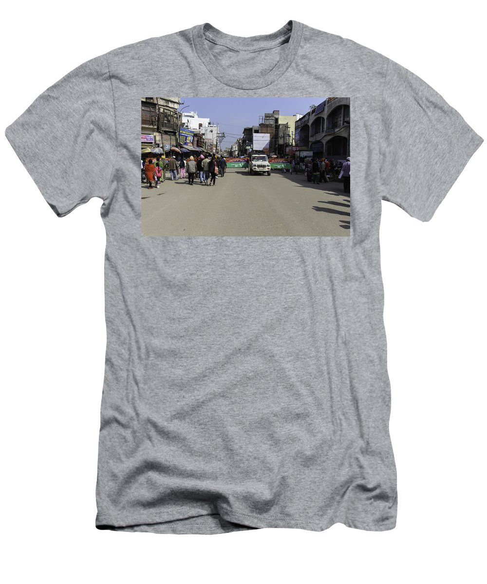 Action Men's T-Shirt (Athletic Fit) featuring the photograph Police Vehicle Emerging Through Barricades In Front Of Golden Temple by Ashish Agarwal
