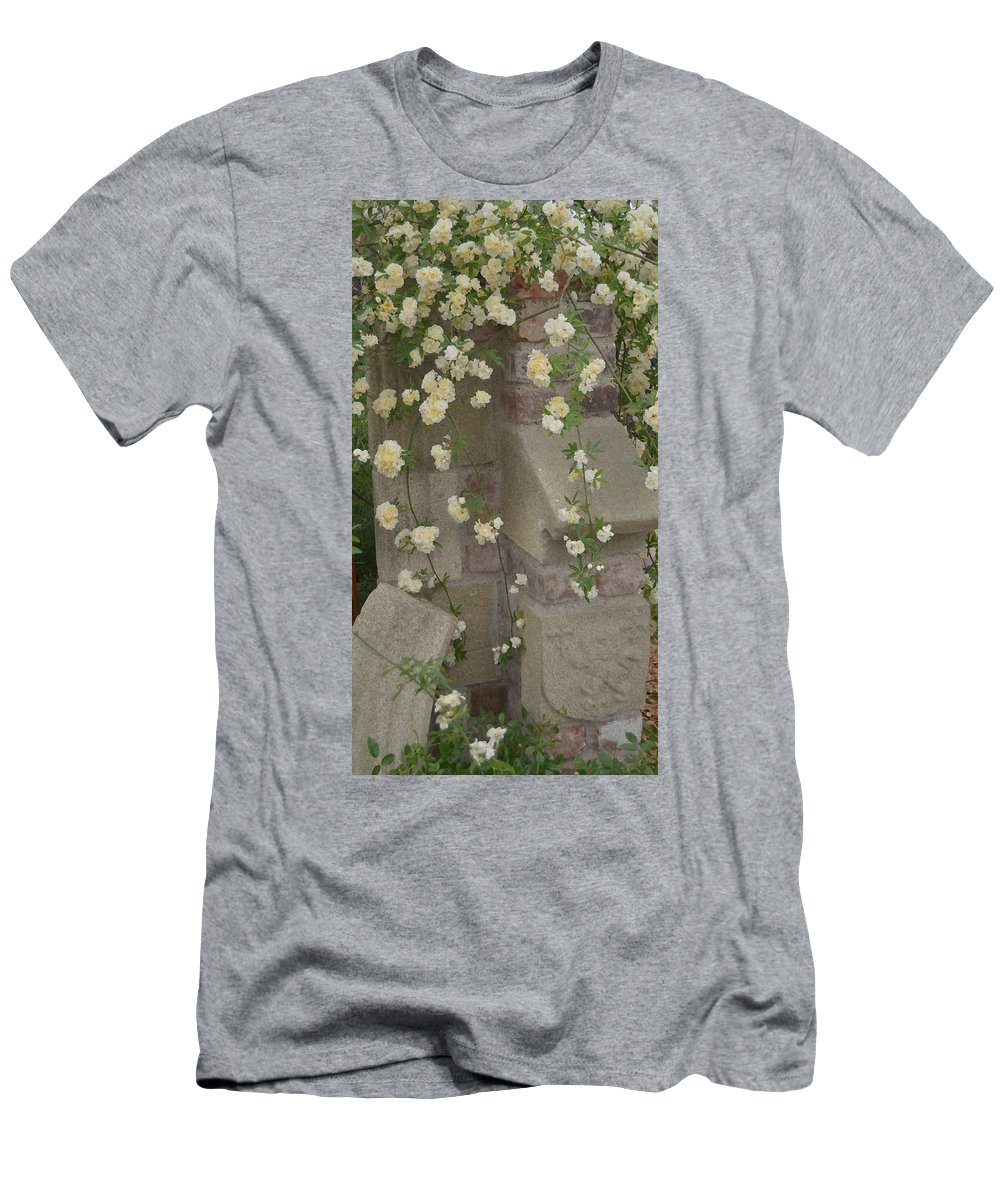 Evocative Men's T-Shirt (Athletic Fit) featuring the photograph Rose Sprawling On Stone by Tom Wurl