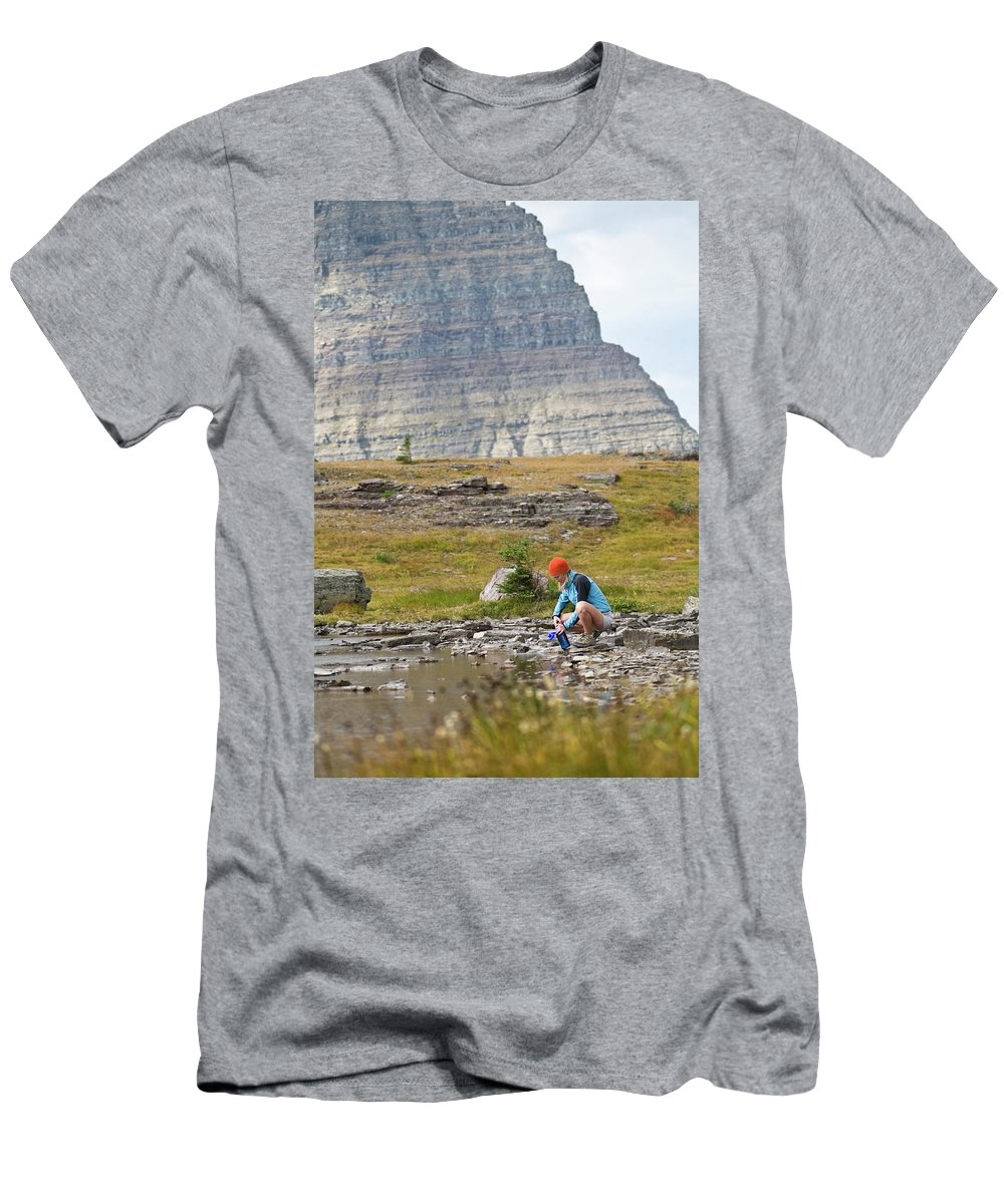 20s Men's T-Shirt (Athletic Fit) featuring the photograph Solo Female Camper Filtering Water by Heath Korvola