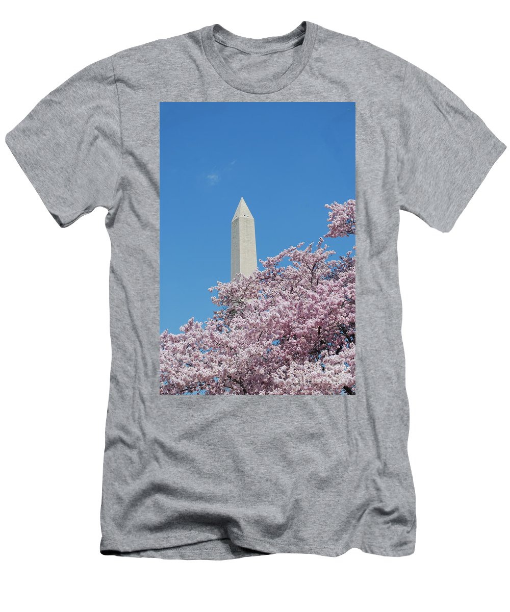 Washington Monument Men's T-Shirt (Athletic Fit) featuring the photograph Washington Monument With Cherry Blossoms by DejaVu Designs