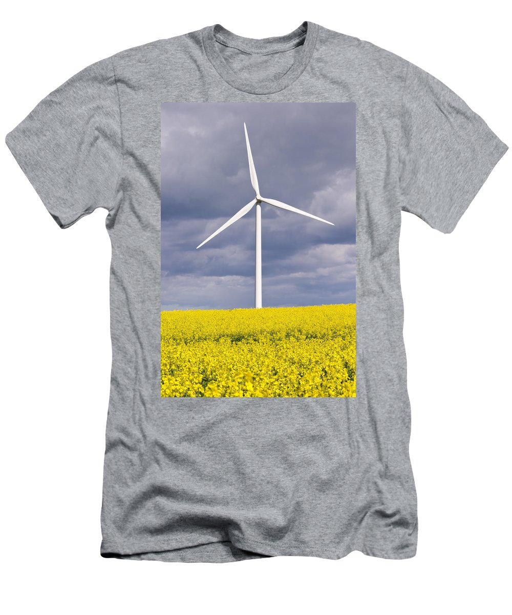 Agriculture Men's T-Shirt (Athletic Fit) featuring the photograph Wind Turbine With Rapeseed by David Head
