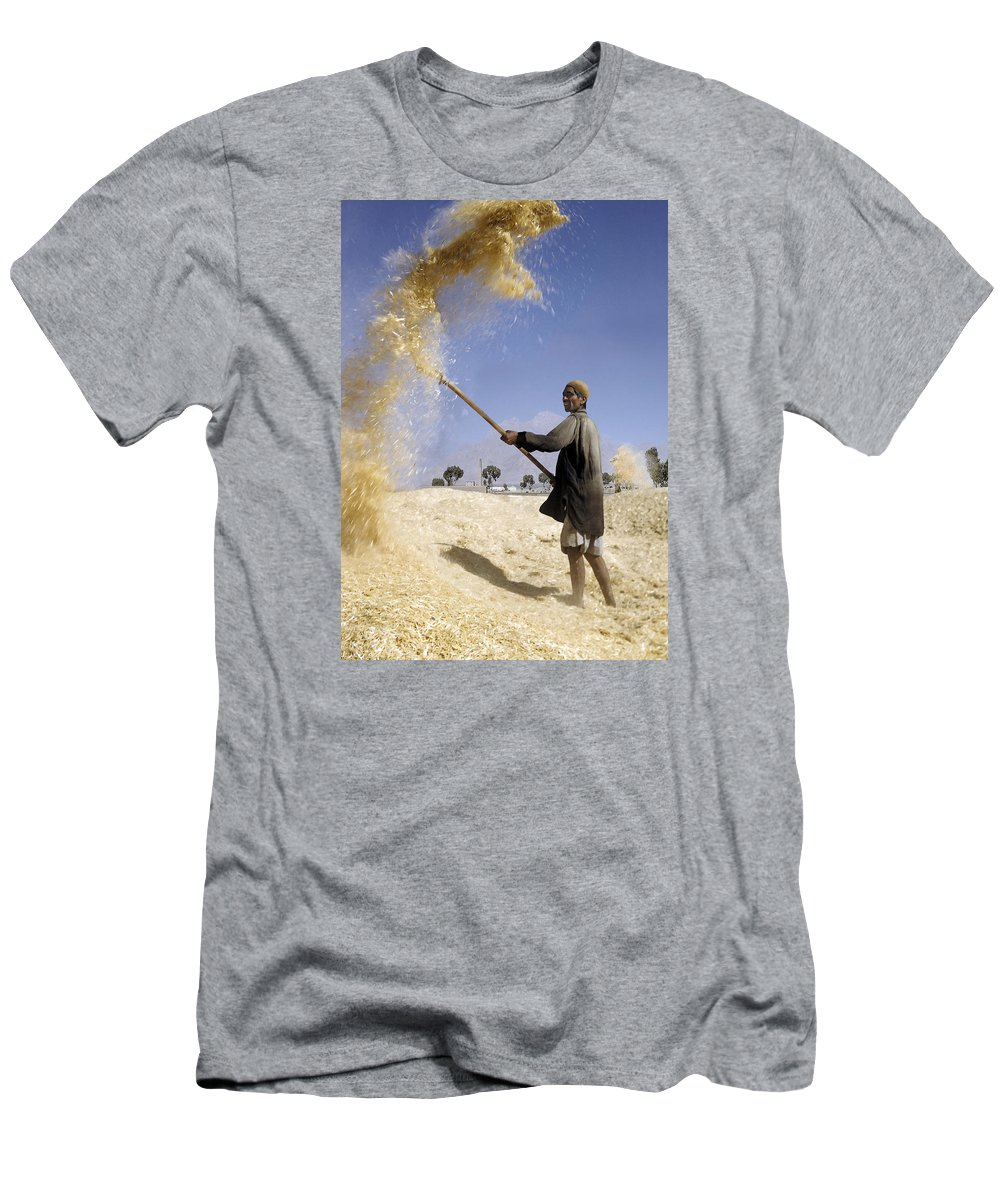 Winnowing Wheat Men's T-Shirt (Athletic Fit) featuring the photograph Winnowing Wheat In Iran by David Murphy