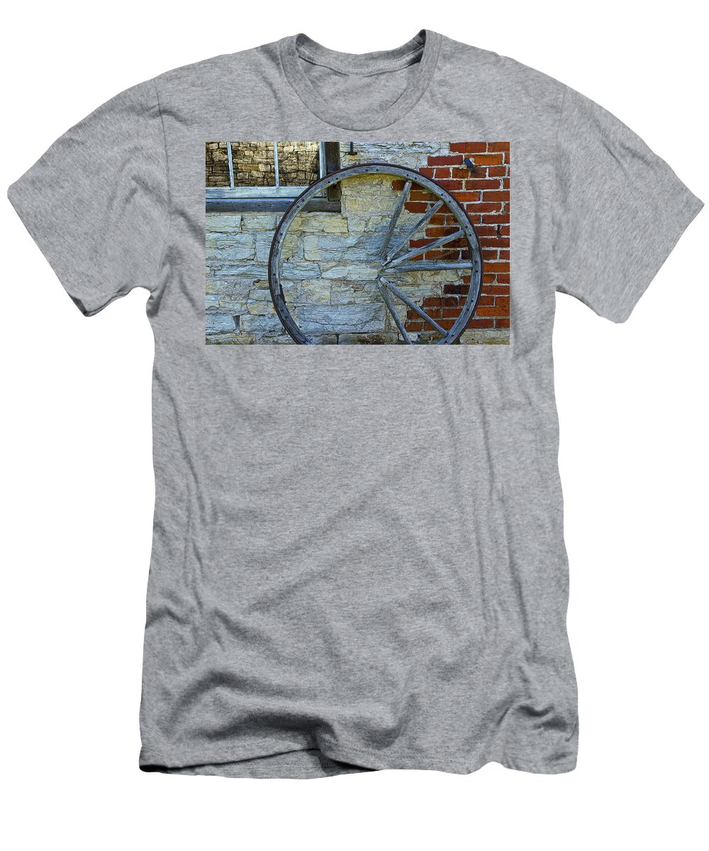 Wagon Wheel Men's T-Shirt (Athletic Fit) featuring the photograph Broken Wagon Wheel Against The Wall by Randall Nyhof