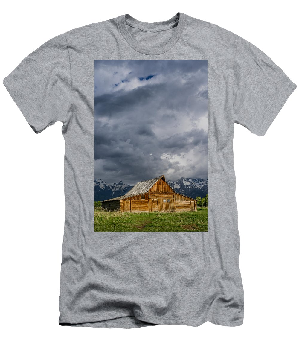 Grand Tetons National Park Men's T-Shirt (Athletic Fit) featuring the photograph Molton Barn And Approaching Storm by Greg Nyquist
