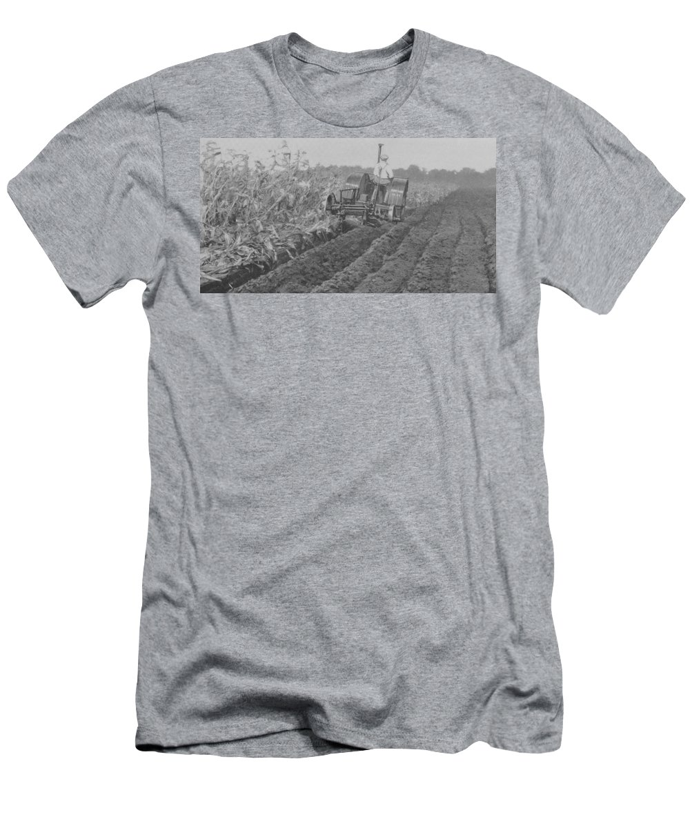 Farm Men's T-Shirt (Athletic Fit) featuring the photograph A Farmer Driving A Tractor by American School
