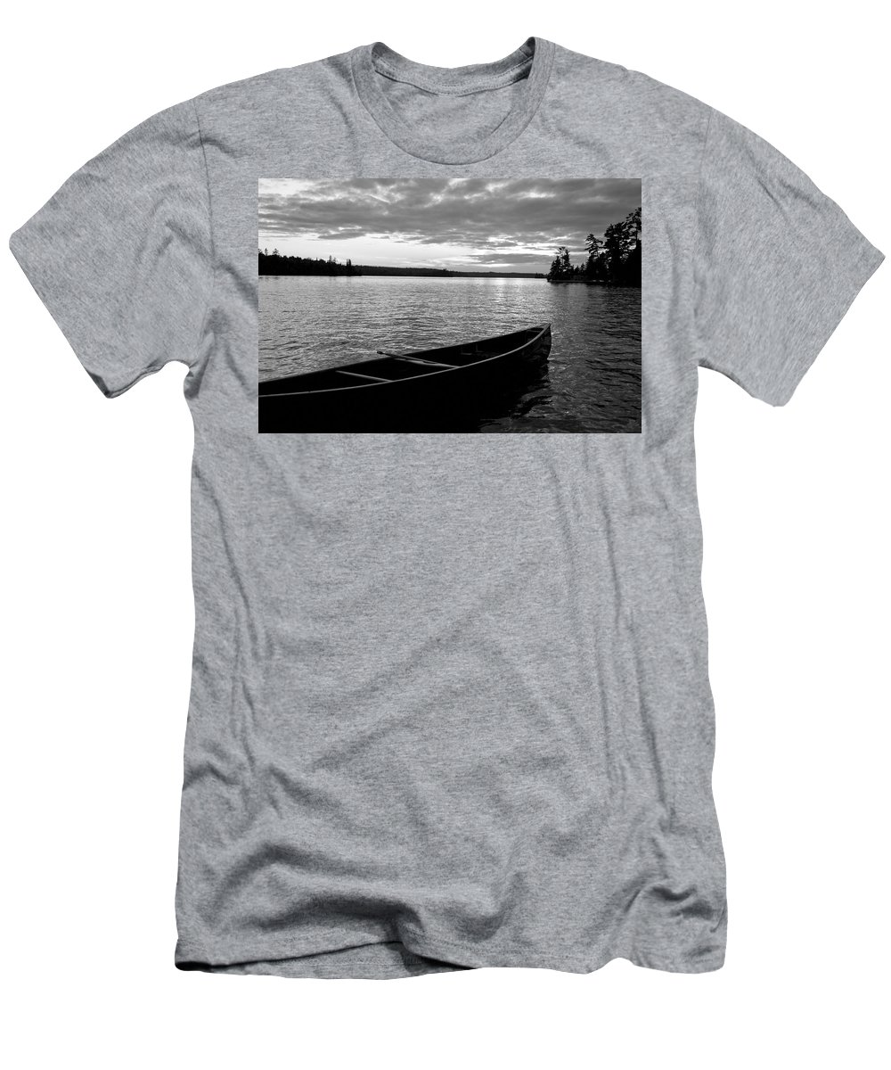 Absence Men's T-Shirt (Athletic Fit) featuring the photograph Abandoned Canoe Floating On Water by Keith Levit