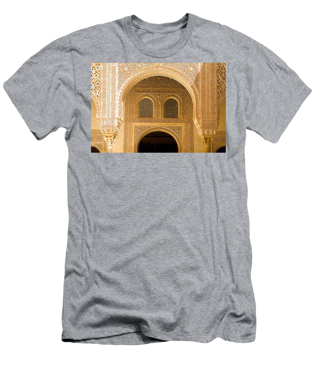 Cuarto Men's T-Shirt (Athletic Fit) featuring the photograph Arabesque Ornamental Designs At The Casa Real In The Nasrid Palaces At The Alhambra by Mal Bray