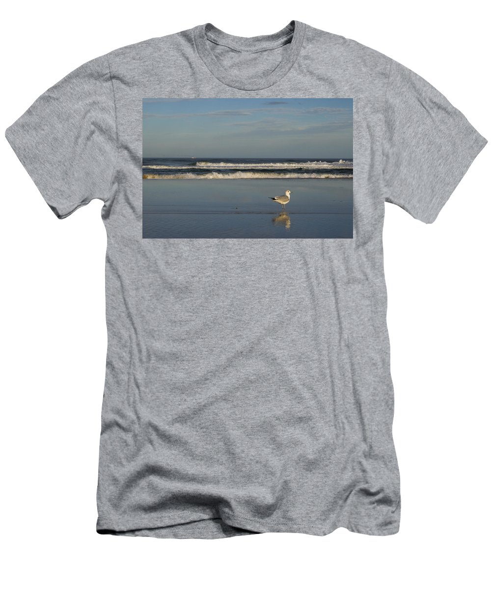 Sea Ocean Gull Bird Beach Reflection Water Wave Sky Men's T-Shirt (Athletic Fit) featuring the photograph Beach Patrol by Andrei Shliakhau