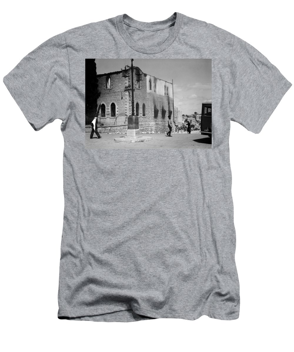 Bethlehem Men's T-Shirt (Athletic Fit) featuring the photograph Bethlehem Police Barracks Burned Down On 1938 by Munir Alawi