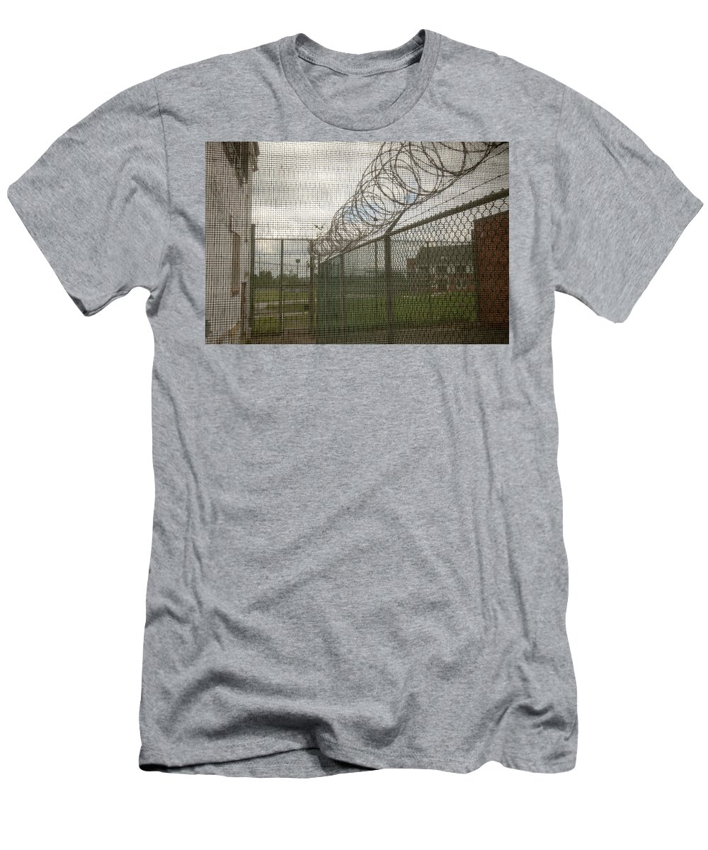 Abandoned Men's T-Shirt (Athletic Fit) featuring the photograph Exercise Yard Through Window In Prison by Karen Foley