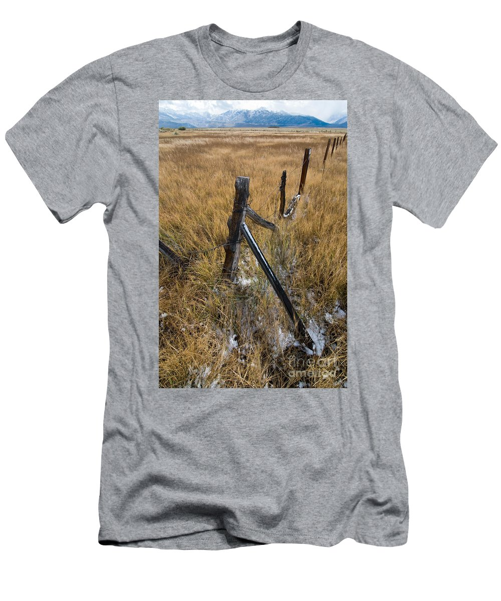 Landscapes Men's T-Shirt (Athletic Fit) featuring the photograph Fence To Nowhere by Norman Andrus