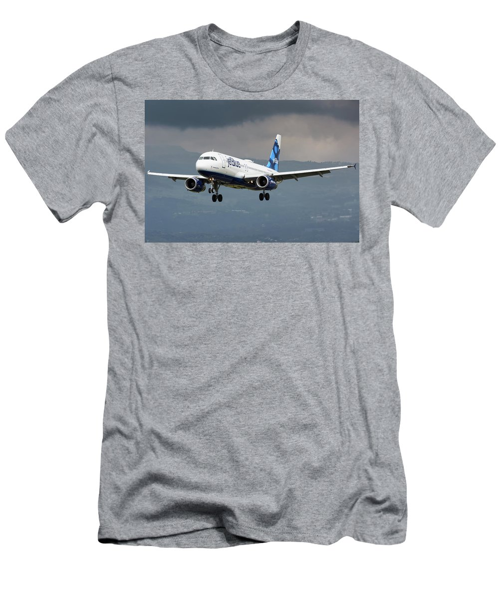Jetblue Airways Airbus A320 Landing San Jose Costa Rica Mroc Sjo Aviation Airplane Landing Men's T-Shirt (Athletic Fit) featuring the photograph jetBlue A320 landing with mountain by Andres Meneses
