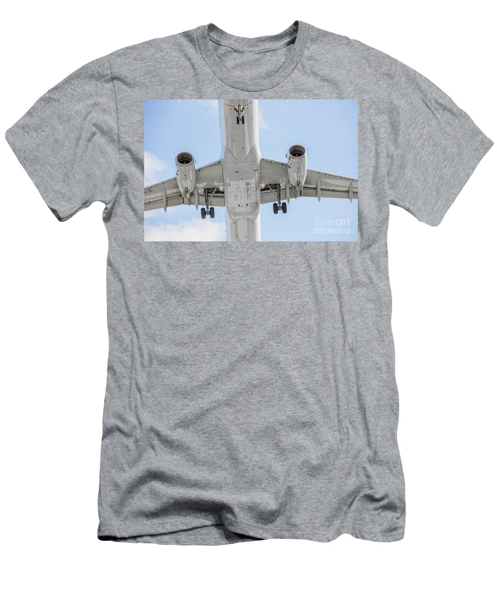Commercial Men's T-Shirt (Athletic Fit) featuring the photograph Passenger Jet Coming In For Landing 1 by PhotoStock-Israel